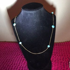 Gold and blue necklace.